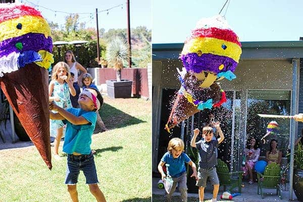 How to Host an Ice Cream Social || The kids had so much fun taking turns trying to burst this ice cream piñata! It was chock full of tasty treats to take home and colorful paper confetti || @thismessisours #FriendsWhoFete