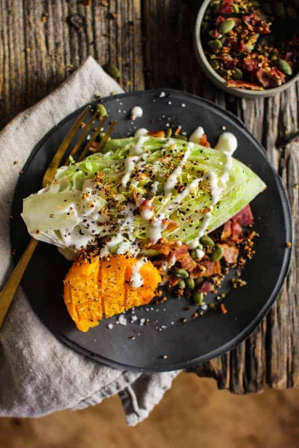 Roasted Butternut and Ranch Autumn Wedge Salad recipe    Butternut squash truly shines in this ranch smothered wedges salad with garlic laced crispy quinoa and smoky bacon.    @thismessisours @litehousefoods #spon