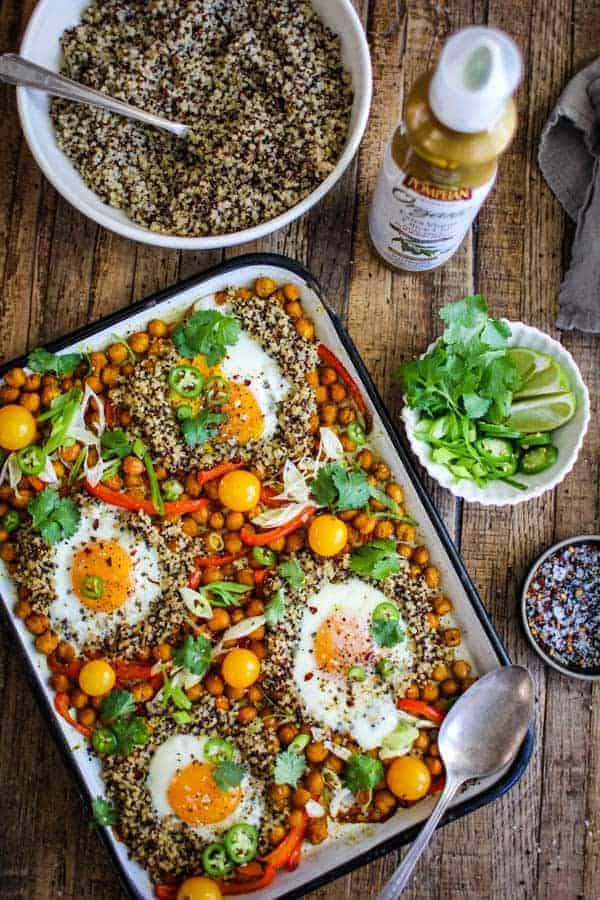 Sheet-Pan Indian Spiced Chickpeas and Eggs recipe || This easy weeknight dinner comes together quickly with minimum hands on time for busy weeknights. toss in shredded rotisserie chicken for for the meat eaters at your table or leave as as for meatless Monday! || @thismessisours #TrendingInTheKitchen @pompeian #ad
