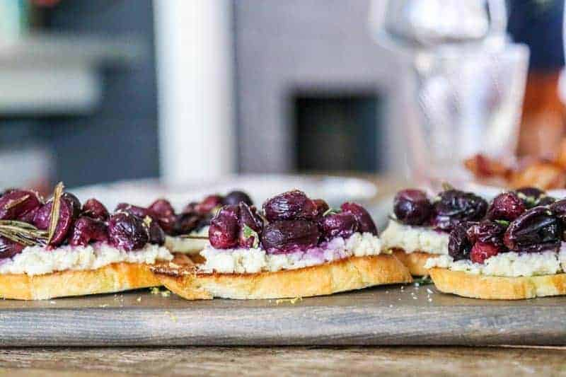 almond ricotta and topped with roasted rosemary grapes piled high on toasted baguette slices
