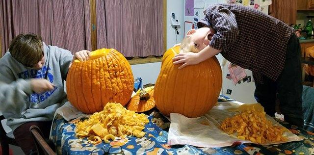 Caving pumpkins for Halloween.