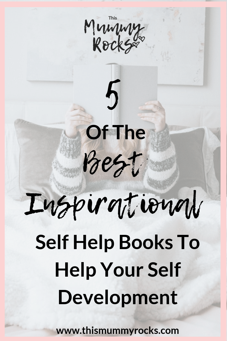 5 of the best inspirational self help books to help your self development. Woman sat in a bed with white bedding, wearing a grey and white stripped jumper. Holding a book with both hands over her face.