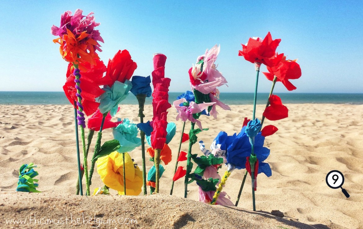 At the beach you dont need money to buy flowers this must be belgium its a typical belgian tradition on a nice summer day at the beach children making paper flowers arranging them in the sand and then selling them to mightylinksfo