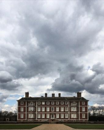 Ham House under a brooding sky.