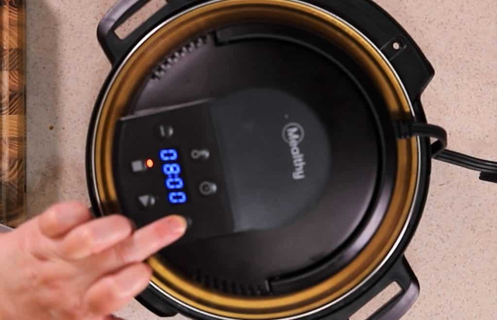 Place the CrispLid on top of the Instant Pot