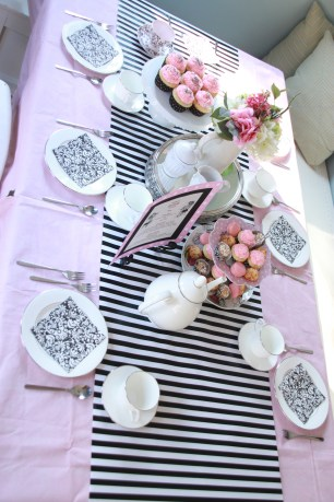The table is set, compete with matching table cloth and runner.