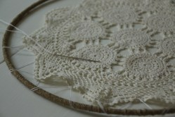 Sew the doily in place (should have 1.5 to 1 inch around the outside between doily and lace.