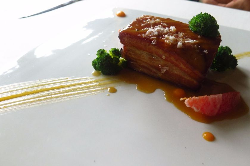 confit pork belly served with a citrus glaze