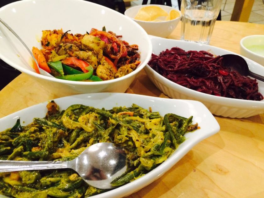 Coconut curried green beans ($7), saffron rice bowl with black pepper chicken ($14), coconut curried beets ($7)