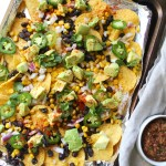 These Loaded Vegan Nachos are packed with healthy ingredients and are the perfect snack to share on game day | ThisSavoryVegan.com