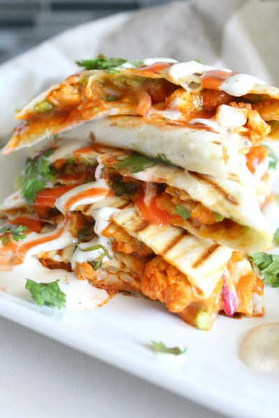 Spice up your next lunch with thisVegan Buffalo Cauliflower Quesadillas. A creamy, spicy combo of marinated cauliflower, vegan ranch and buffalo sauce   ThisSavoryVegan.com