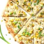 This Vegan Mashed Potato White Pizza is the ultimate comfort food. Creamy white base, mashed potatoes, fresh corn and savory gravy on top of crispy crust | ThisSavoryVegan.com #vegan #veganpizza