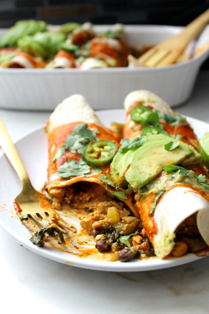 TheseBlack Bean Tofu Scramble Vegan Enchiladas are loaded with a hearty tofu scramble of black beans & veggies and are topped off with a green chili cream sauce | ThisSavoryVegan.com #vegan #veganenchiladas