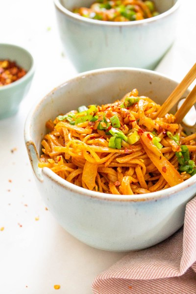These Spicy Thai Noodles are quick, simple and totally mouthwatering. Bulk them up with extra veggies for a better than takeout vegan dinner at home | ThisSavoryVegan.com #thissavoryvegan #spicynoodles #vegannoodles