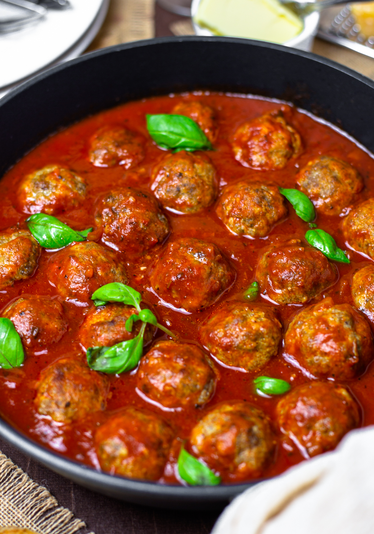 Close up of Homemade Meatballs in sauce with basil pieces