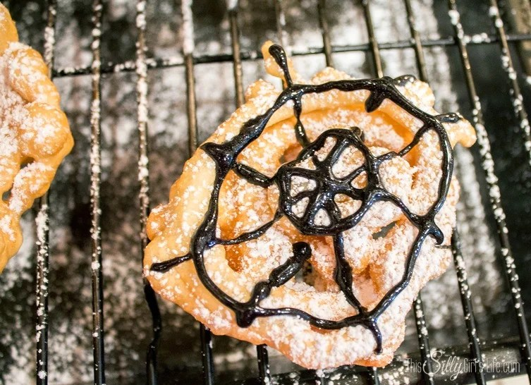 Crispy Spider Webs {Mini Funnel Cakes} perfect for a Halloween party or a treat before the little ones go trick or treating! Recipe from https://ThisSillyGirlsLife.com #Halloween #SpiderWeb #SpiderTreats #FunnelCakes #Mini