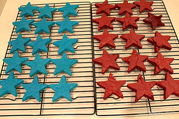 Let cool on wired rack until completely cooled. Using a medium star cookie cutter, cut out star shapes. Try to get them as close together as possible, you should be able to get 15 stars from each color. Cut dough with cutter, wiggle cutter to loosen brownie from bottom of pan. Brownie should lift off with cutter, carefully place brownie on wired rack or surface of you choice until ready to frost.