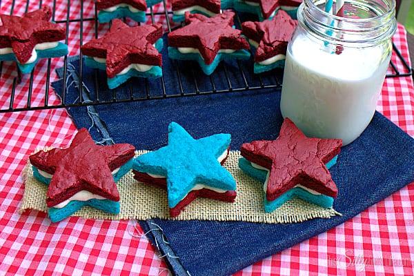 Patriotic Brownie Sandwich Cookies, decadent cream cheese frosting sandwiched between blue and red velvet brownies!