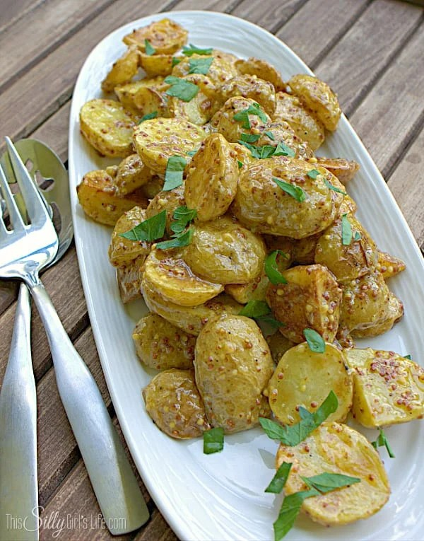 French Style Roasted Potato Salad, baby yellow potatoes roasted at high heat, tossed in a flavorful whole mustard dressing and garnished with fresh parsley.