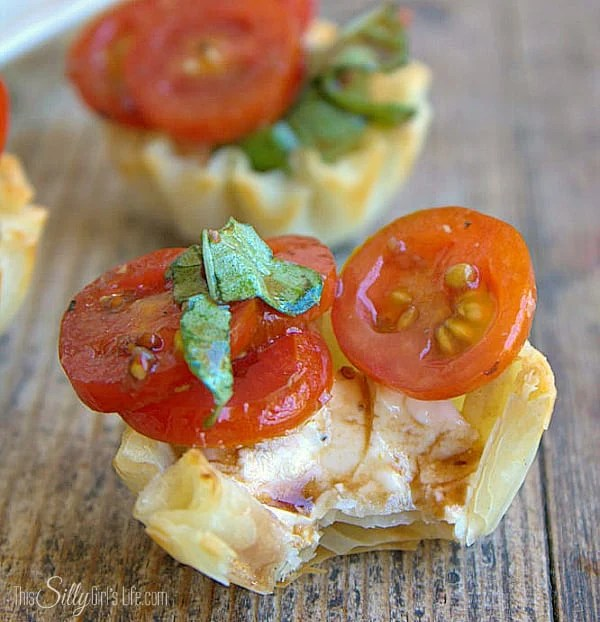Creamy Bruschetta Bites, Parmesan cream cheese piped into phyllo cups and topped with tomato basil bruschetta! - ThisSillyGirlsLife.com