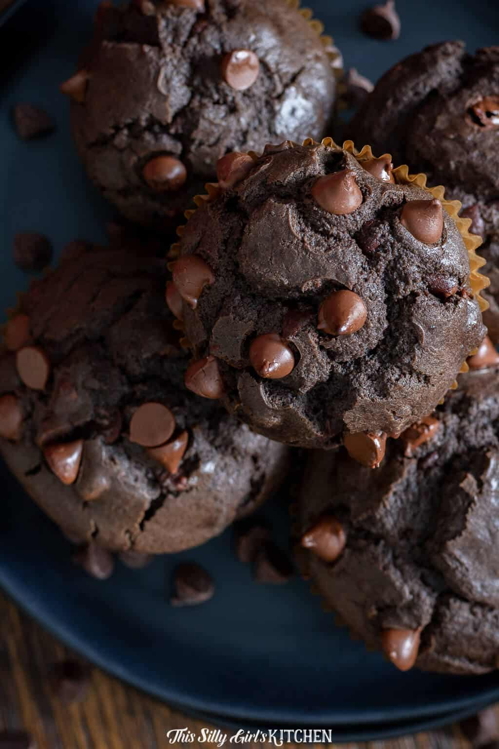 Overhead of Chocolate Chip Muffins on dark plate