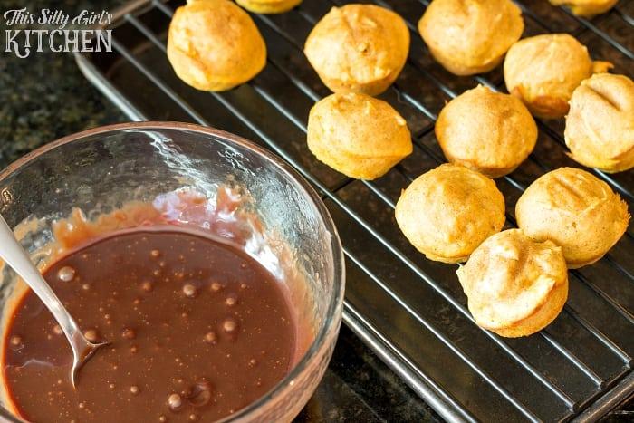 Baked Chocolate Glazed Pumpkin Donut Holes, bite sized pumpkin donuts dipped in chocolate ganache!
