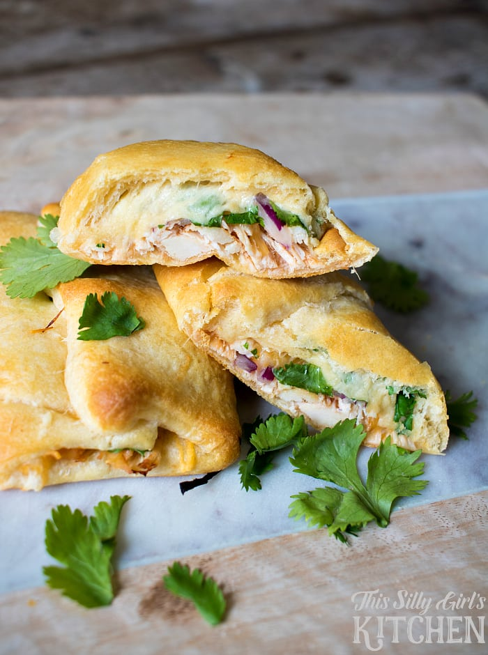 BBQ Chicken Pizza Crescent Rolls, crescent rolls stuffed with bbq chicken, red onion, cilantro and of course... CHEESE!! from ThisSillyGirlsLife.com