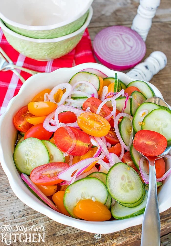 Tomato, Cucumber and Onion Salad, bright, refreshing and perfect for summer! from ThisSillyGirlsLife.com