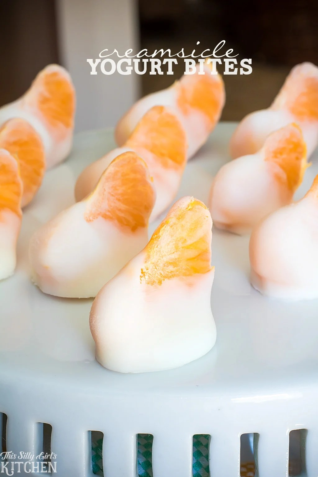 Creamsicle Yogurt Bites, clementines dipped in vanilla yogurt and frozen for a fun, healthy snack! from ThisSillyGirlsKitchen.com AD