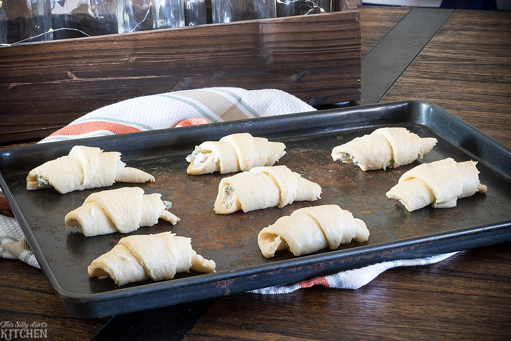 AD Bacon Jalapeno Popper Cream Puffs, jalapenos, bacon, and cream cheese stuffed in crescents rolls and baked. from ThisSillyGirlsKitchen.com #LoveThisHolidayTwist