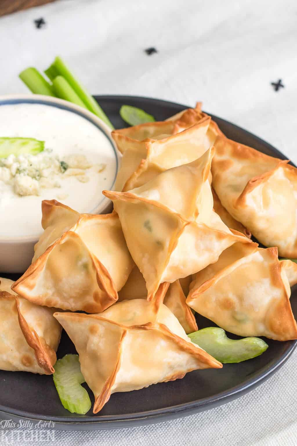 AirFryer Buffalo Chicken Wontons, only 6 ingredients and ready in 15 minutes, perfect for game day! #Recipe from ThisSillyGirlsKitchen.com #buffalochicken #wontons #airfryer