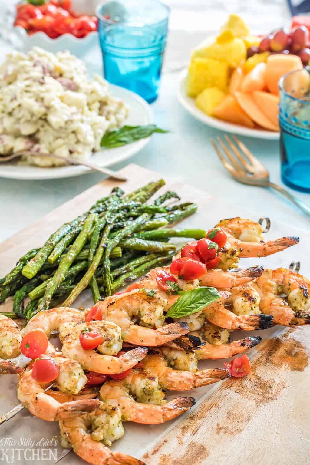 Bruschetta Grilled Shrimp on wooden board with asparagus