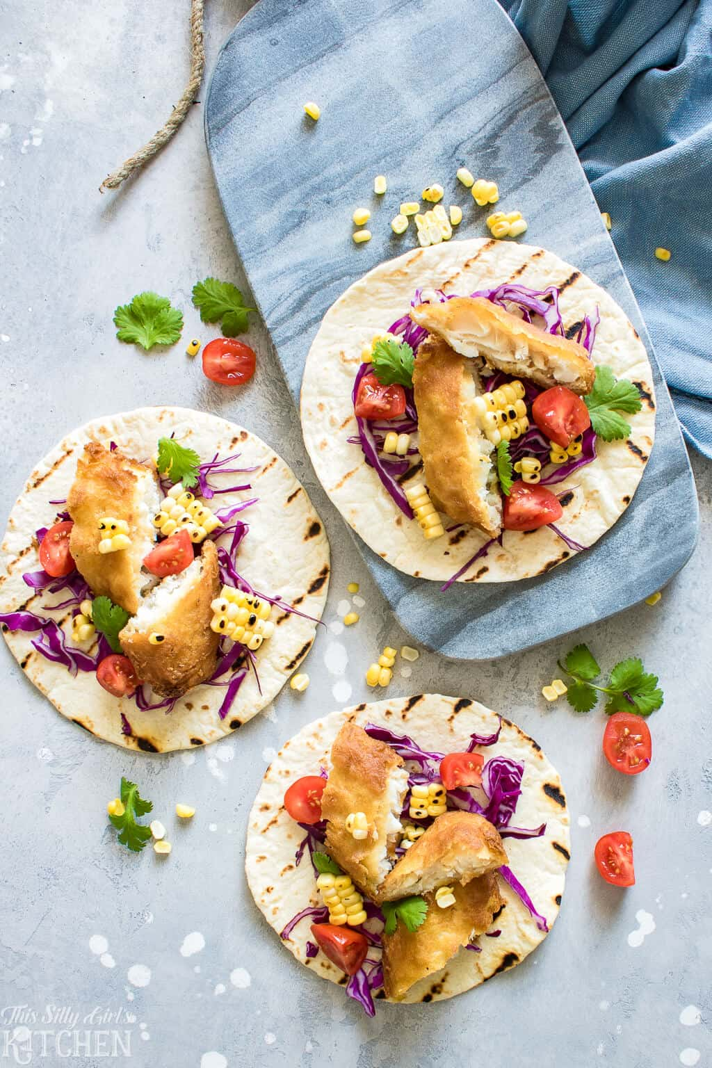 Easy Fish Tacos with Creamy Chimichurri Sauce, an easy weeknight meal you will make again and again! #Recipe from ThisSillyGirlsKitchen.com #fishtaco #taco #chimichurri