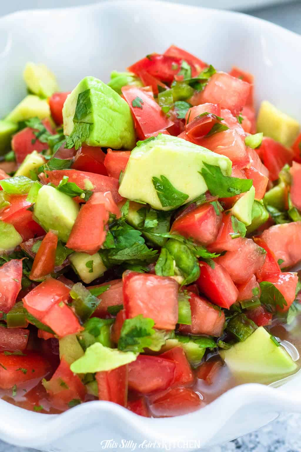 Close up of Avocado Salsa in bowl showing all ingredients chopped up