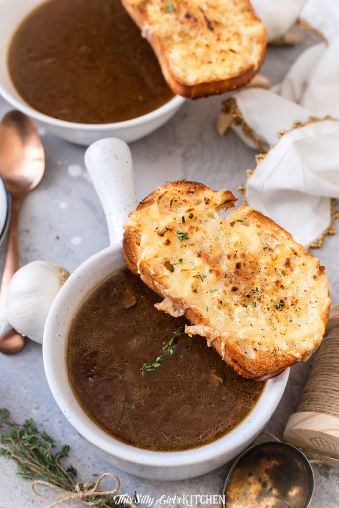 Overhead of two bowls of French Onion Soup