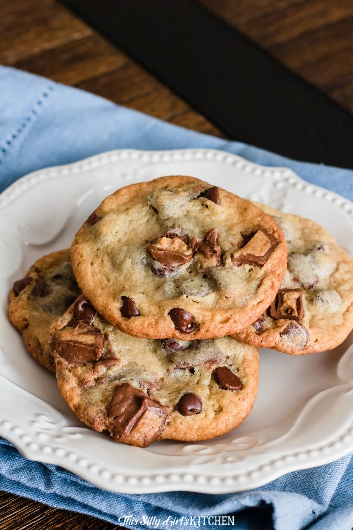 Reese's Peanut Butter Cup Cookies are like classic chocolate chip cookies on steroids. #recipe from thissillygirlskitchen.com #cookies #chocolatechipcookies #peanutbuttercookies #peanutbuttercupcookies #reesespeanutbuttercupcookies