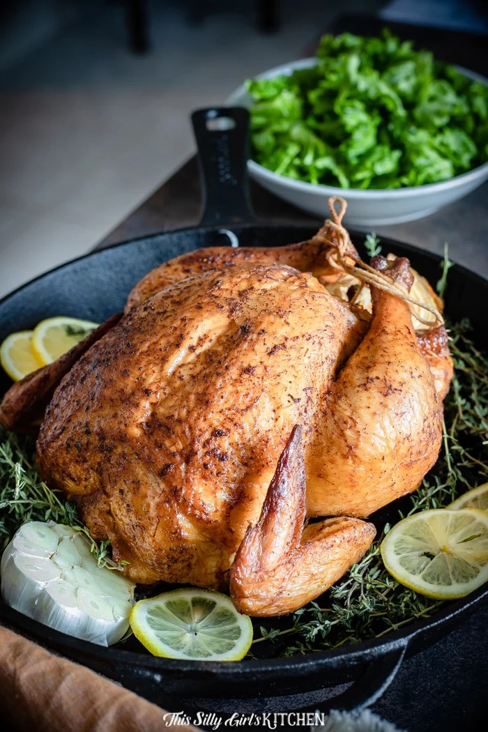 Smoked chicken seems intimidating, I get it, but one of my favorite ways to cook chicken is to smoke it. #recipe from thissillygirlskitchen.com #smokedchicken #wholesmokedchicken #roastedchicken #wholechicken #grilledchicken #chicken