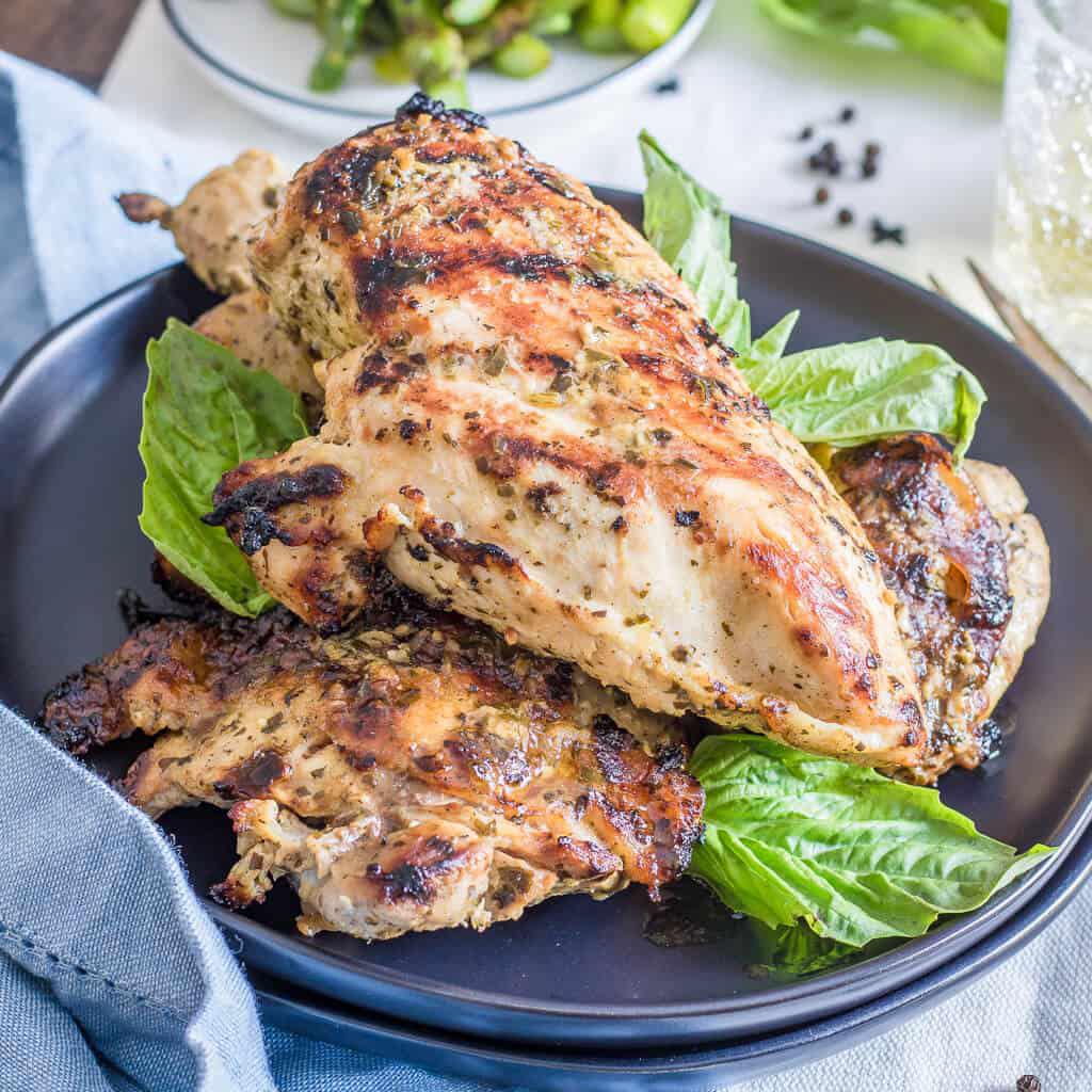 Pesto Chicken Marinade on grilled chicken square image