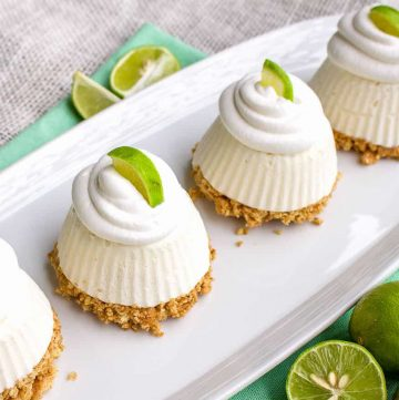 Close up of Mini Key Lime Pies on white platter square image
