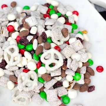 Overhead close up Christmas Trail Mix on white plate square image