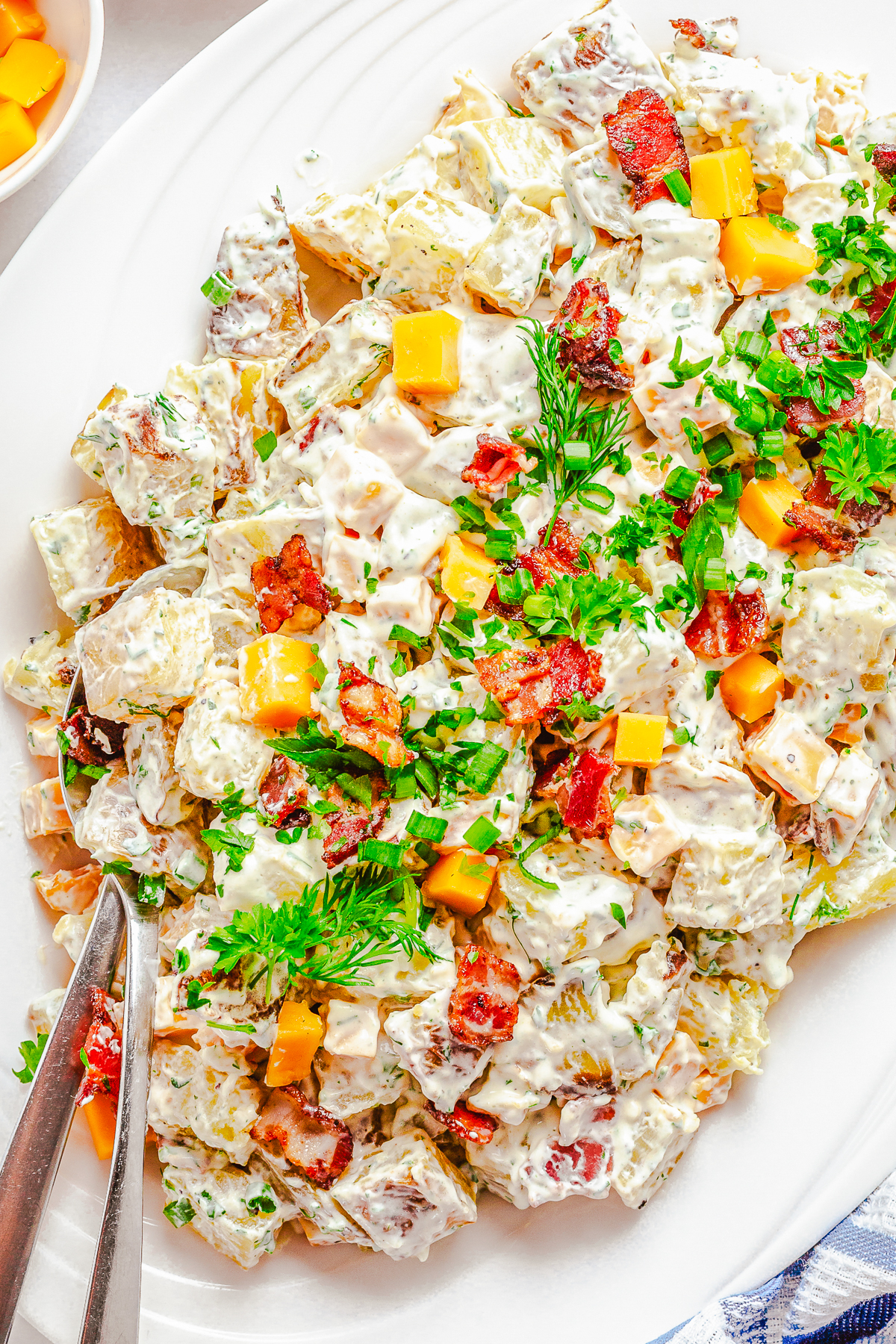 Close up overhead of Potato Salad with spoons in salad