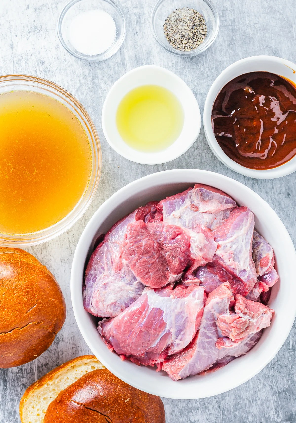 Ingredients needed to make Slow Cooker BBQ Beef Sandwiches.
