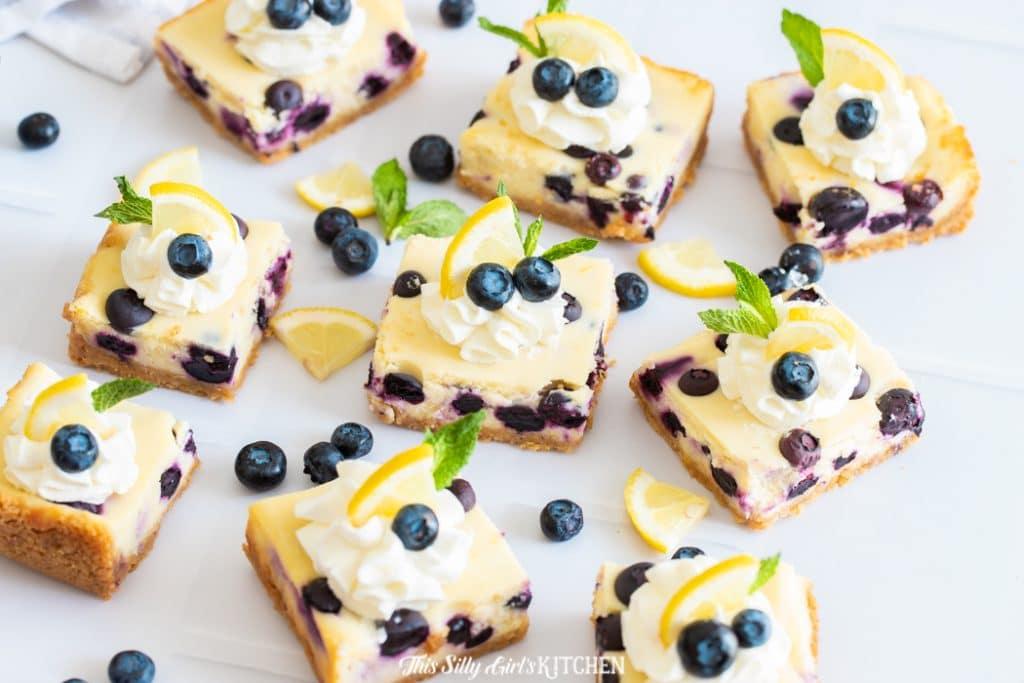 cheesecake bars with blueberry garnish