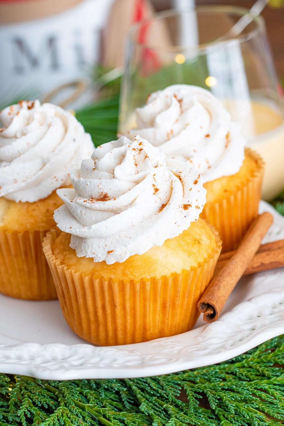 Three cupcake on white plate