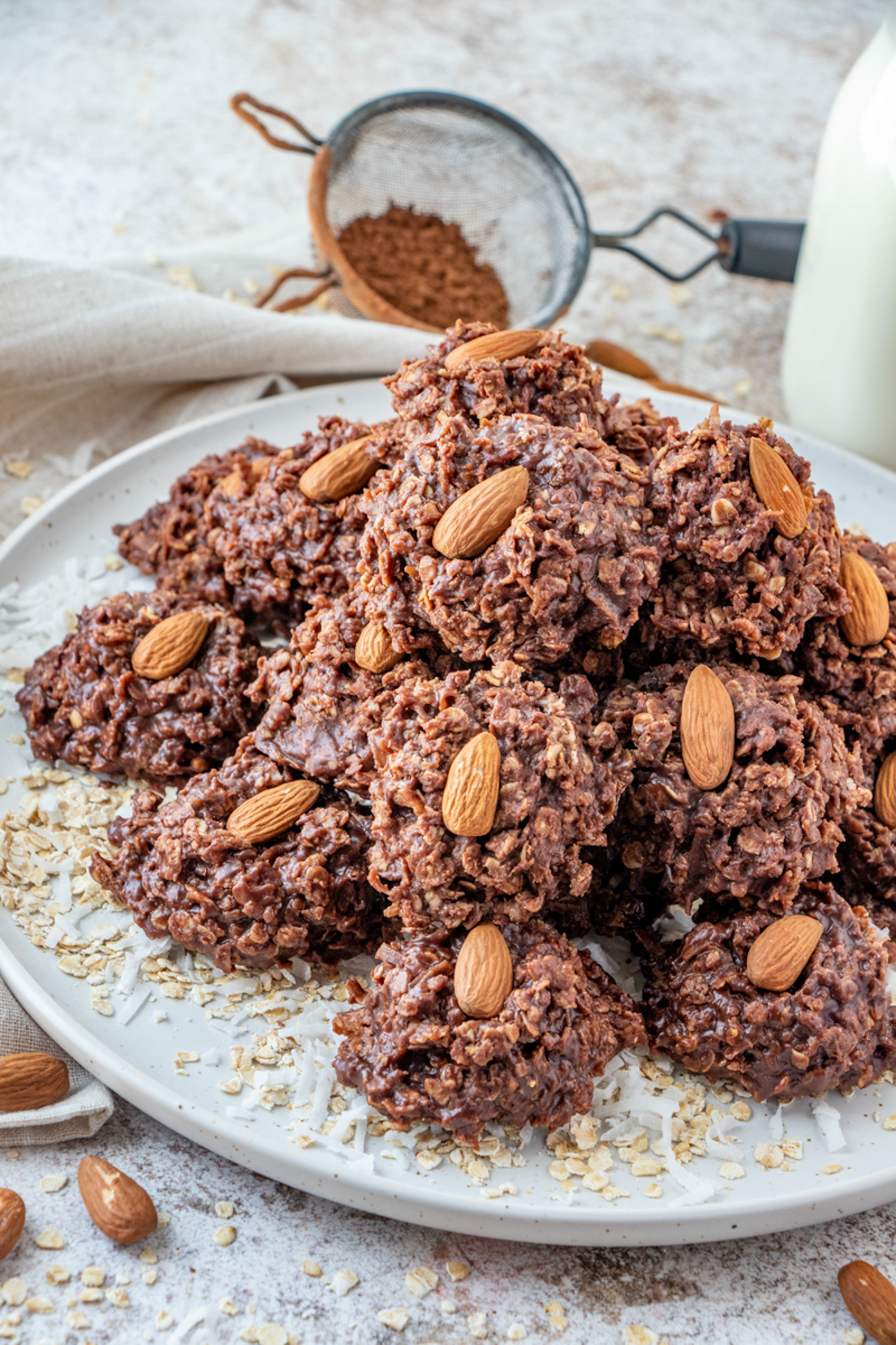 Plate full of No Bake Almond Joy Cookies topped with almonds