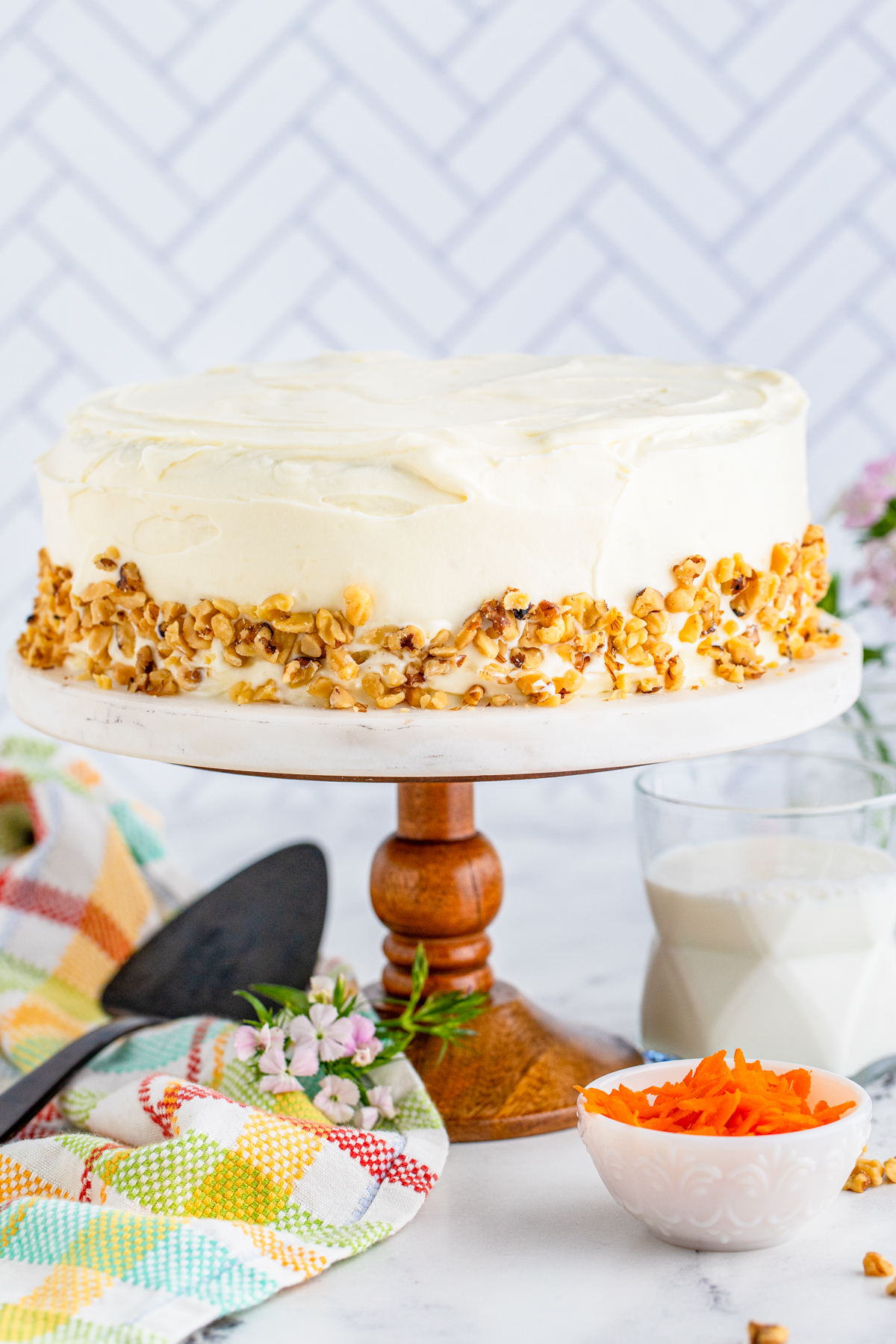 Layered Carrot Cake on cake stand frosted