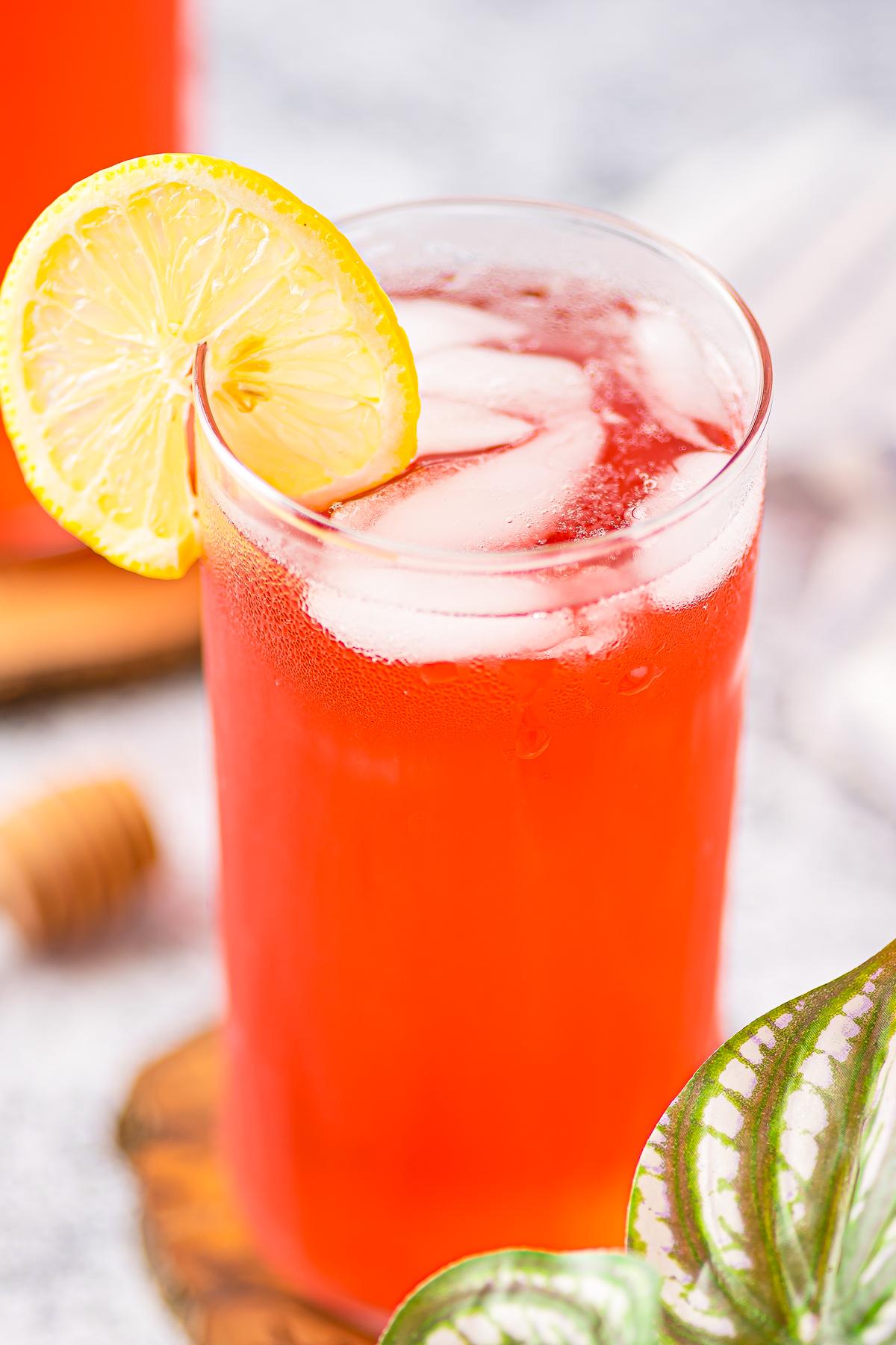Overhead of Hibiscus Tea Recipe showing ice and lemon garnish