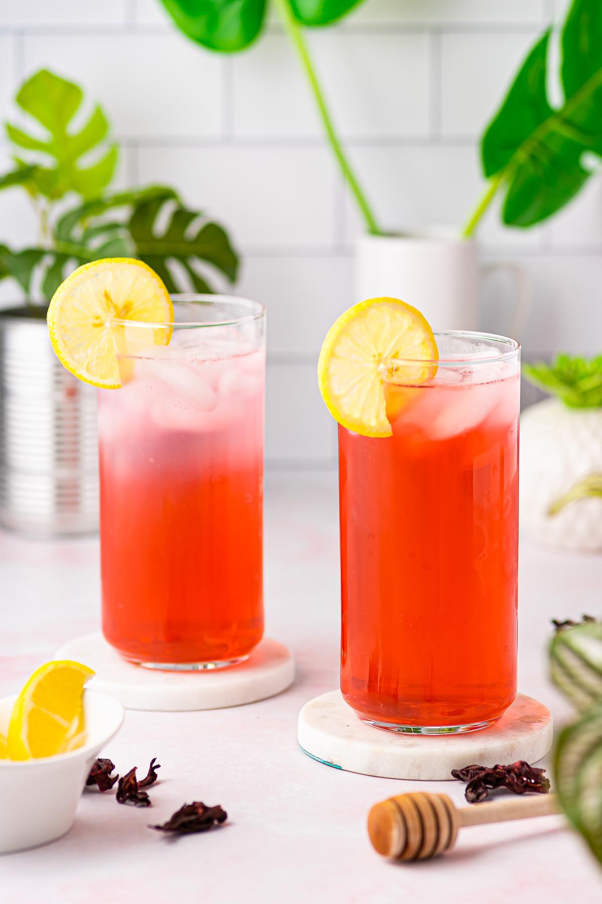 Two glasses garnished with lemon full of tea