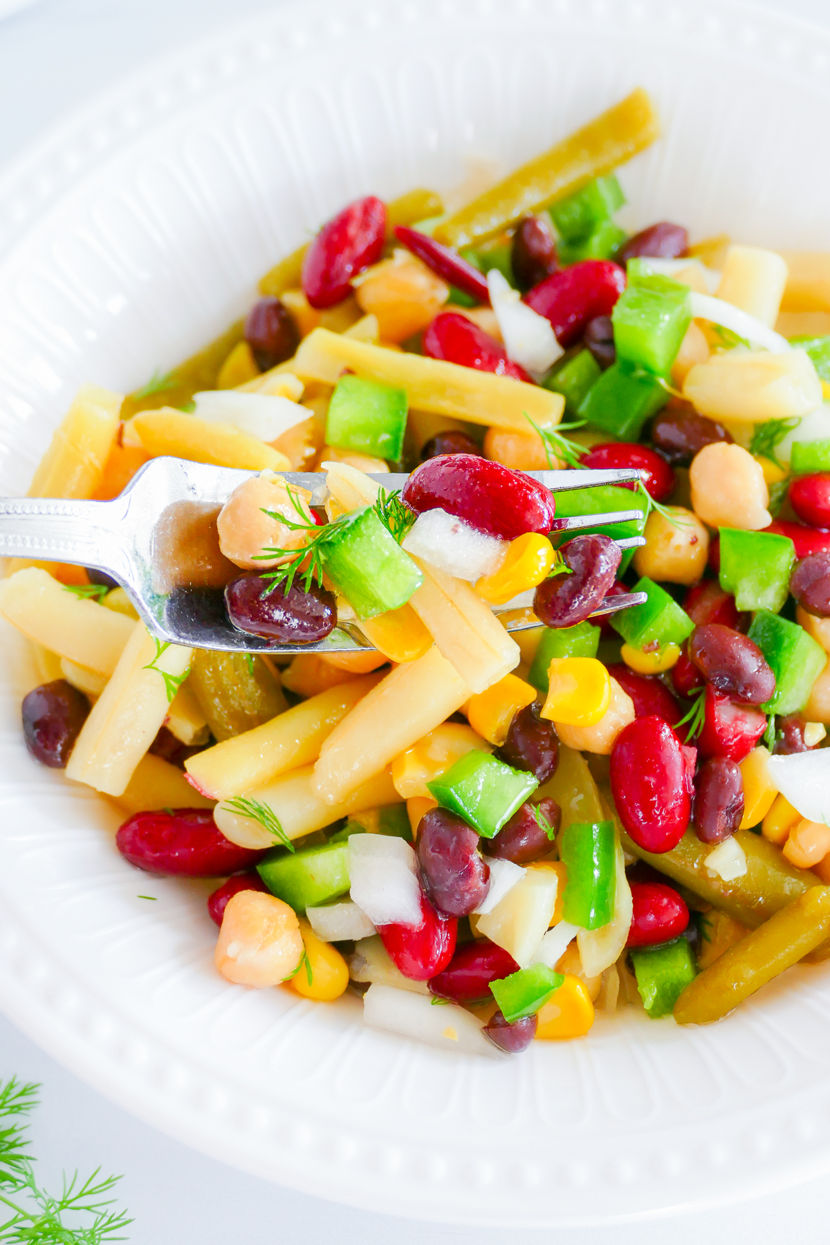 Fork holding up some of the 5 Bean Salad