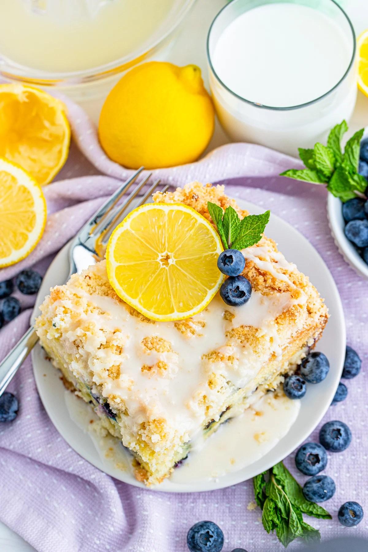 Overhead photo of slice of Lemon Blueberry Cake on white plate